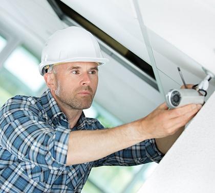 a man installing CCTV Cameras